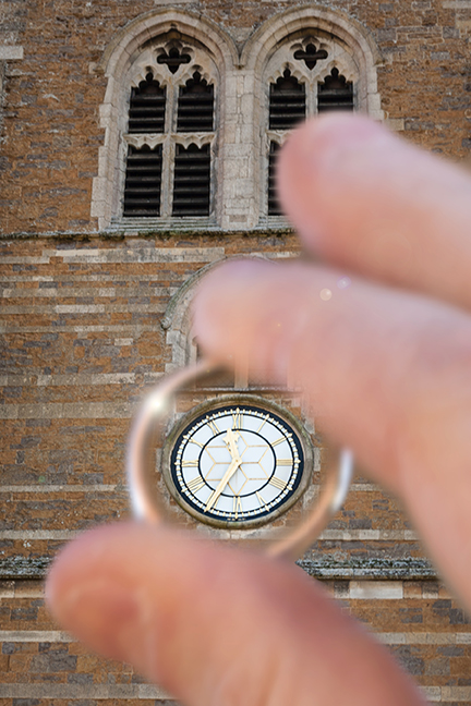 View of clock through a wedding ring - Issi Greig wedding photography
